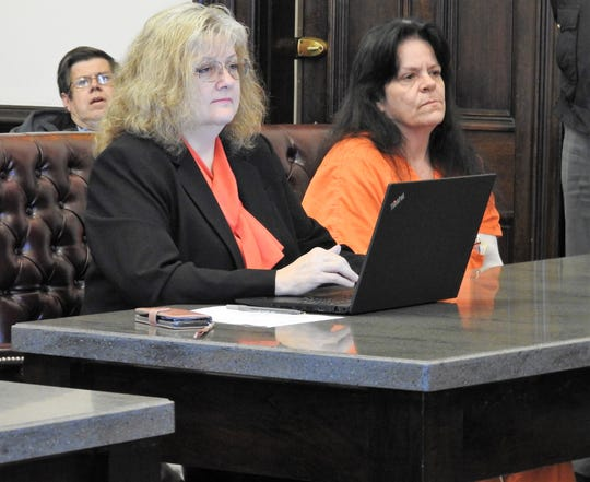 Attorney Marie Seiber with Candy Kae Petrekovich for an arraignment hearing Tuesday in Coshocton County Common Pleas Court. Petrekovich entered not guilty pleas to six chargs relating to the murder of Gilbert Dale Walton Jr.