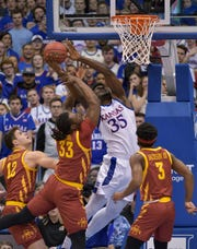 Feb 17, 2020; Lawrence, Kansas, USA; Kansas Jayhawks center Udoka Azubuike (35) shoots and is fouled by Iowa State Cyclones forward Solomon Young (33) during the first half at Allen Fieldhouse. Mandatory Credit: Denny Medley-USA TODAY Sports