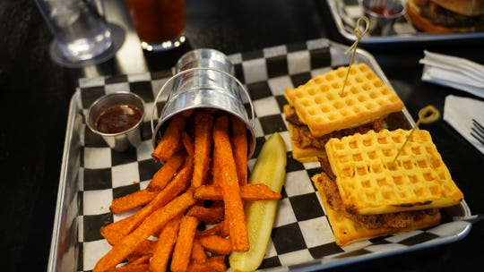 The chicken and waffle sliders, $12, at Pour Choices Neighborhood Bar, 1895 Southeast Grimes Blvd. in Grimes.