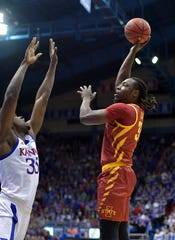 Feb 17, 2020; Lawrence, Kansas, USA; Iowa State Cyclones forward Solomon Young (33) shoots over Kansas Jayhawks center Udoka Azubuike (35) during the first half at Allen Fieldhouse. Mandatory Credit: Denny Medley-USA TODAY Sports