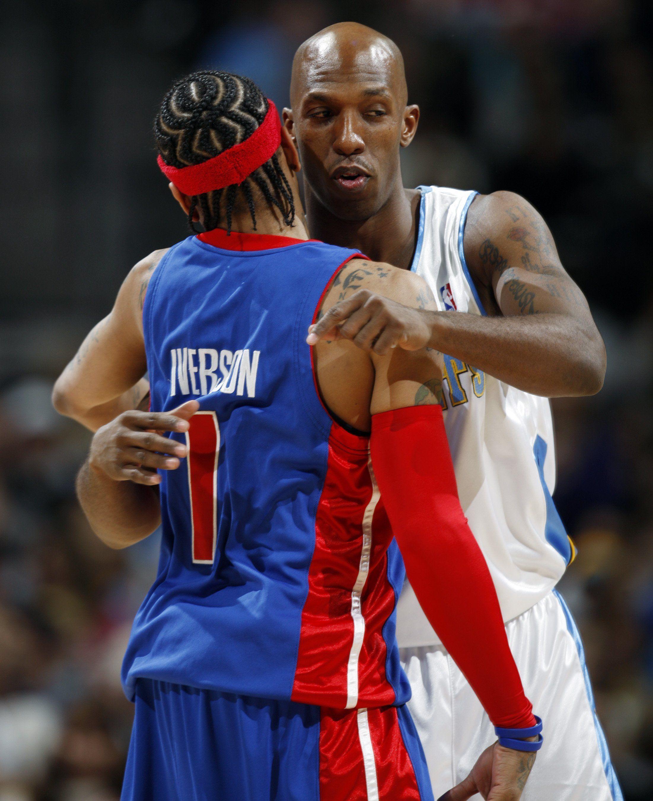 Detroit Pistons guard Allen Iverson, left, hugs Denver Nuggets guard Chauncey Billups before a game in Denver on Jan. 9, 2009.