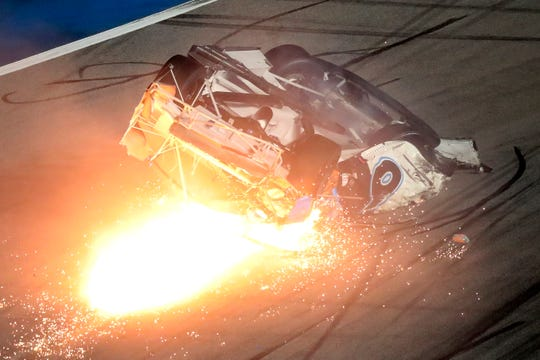 Ryan Newman slides down the track after he was involved in a crash on the final lap.