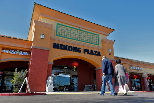 In this Feb. 13, 2020, photo, patrons enter Mekong Plaza in the Asian district, in Mesa, Ariz. Arizona's freshly crowned Asian District was deep into organizing its night market when news broke that a case of the illness known as COVID-19 was confirmed at nearby Arizona State University.