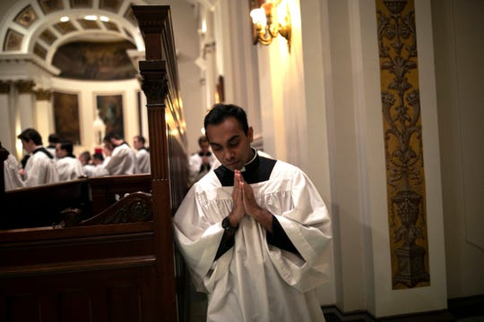 Seminarian Ranjuna Perera from the Archdiocese of Colombo, Sri Lanka, returns to his seat after receiving communion at St. Charles Borromeo Seminary in Wynnewood, Pa., on Wednesday, Feb. 5, 2020.