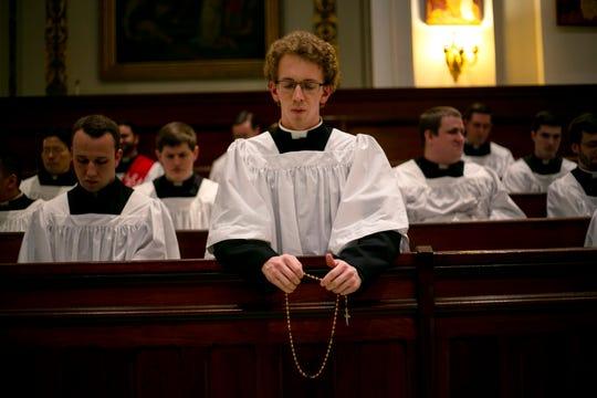 Seminarian Jordan Evans prays the rosary in a chapel at St. Charles Borromeo Seminary in Wynnewood, Pa., on Wednesday, Feb. 5, 2020.