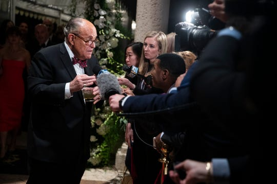 Former New York Mayor Rudy Giuliani, an attorney for President Donald Trump, speaks to reporters as he arrives for a New Year's Eve party hosted by President Donald Trump, Tuesday, Dec. 31, 2019, in Palm Beach, Fla.