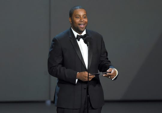 FILE - In this Sept. 17, 2018, file photo Kenan Thompson presents the award for outstanding drama series at the 70th Primetime Emmy Awards at the Microsoft Theater in Los Angeles.