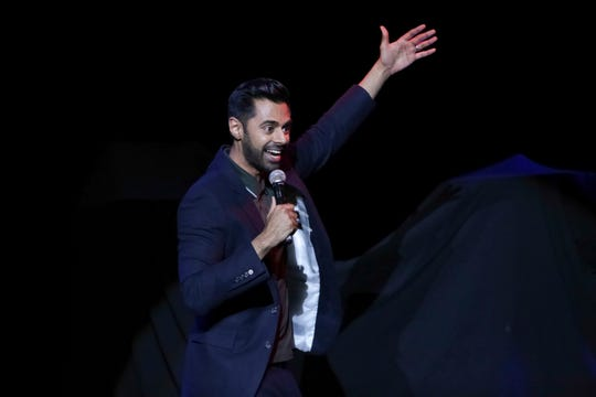 FILE - In this Nov. 7, 2017 file photo, comedian Hasan Minhaj performs on stage during the 11th Annual Stand Up for Heroes benefit, presented by the New York Comedy Festival and The Bob Woodruff Foundation, at the Theater at Madison Square Garden, in New York.