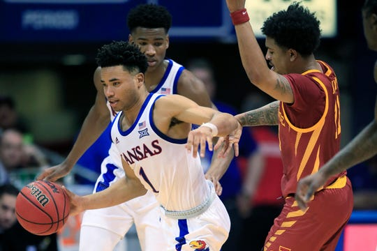 Kansas guard Devon Dotson (1) steals the ball from Iowa State guard Prentiss Nixon (11) during the first half Monday.