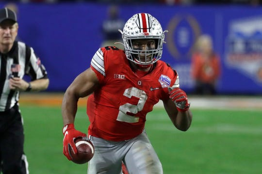 Ohio State running back J.K. Dobbins shouldered a huge workload last season, carrying the ball 300 times on his way to 2,000 yards on the ground.