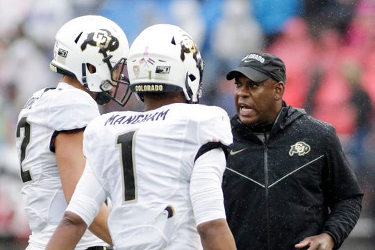 Mel Tucker, right, went 5-7 in his only season at Colorado.
