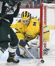 Sophomore goaltender Strauss Mann, seen here facing Michigan State earlier in the season, stopped all 25 shots faced for UM.