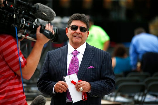 In this Aug. 8, 2015, file photo former owner of the San Francisco 49ers Edward DeBartolo, Jr., is interviewed before the Pro Football Hall of Fame ceremony at Tom Benson Hall of Fame Stadium in Canton, Ohio. President Donald Trump pardoned DeBartolo, who is convicted in gambling fraud scandal.
