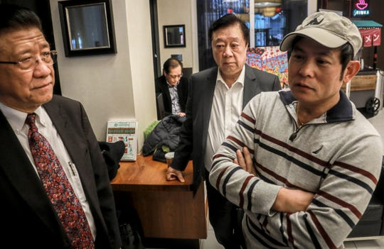 In this Feb. 13, 2020, photo, William Su, left, chairman of the Chinese Association of New York, John Lam, chairman America China Hotel Association, center, Frankie Chu, owner of Vegetarian Dim Sum House restaurant, meet in New York to discuss decline in Chinatown customers amid fears about the viral outbreak that originated in China.
