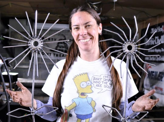 Barbie Parsons of Erin, aka Barbie the Welder, shows off some of her metal sculpture creations.