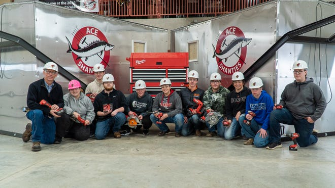 Students from Fond du Lac's ACE Academy built two ice shanties, with help from area businesses. From left are: instructor Vern Widmer and students Lillian Cornils, senior;  juniors Alexander Braatz and Xavior Harmsen,  senior Logan Miller, freshman Isaac Wuest, seniors  Landon Spies, Cody Breister, Samuel Mengel and Parker Zimmerman and junior Jared Cotton.