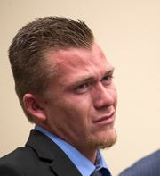 Logan Hetherington tries not to cry during the victim impact statement by Layla Aiken's mother, Kathleen, on Tuesday, Feb. 18, 2020, at the Lee County Justice Center in Fort Myers.