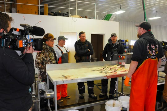Film crews stopped by Lindal Fisheries and Market in Sturgeon Bay while following local fishing guide JJ Malvitz as he explained the art of ice fishing for whitefish.