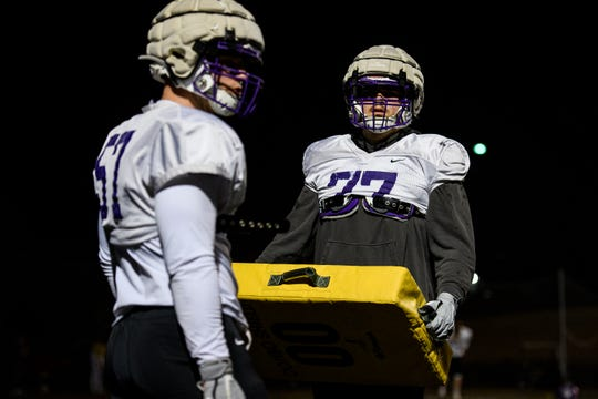 Furman's Jacob Johanning (57) and Bo McKinney (77) prepare to run through drills during practice at Paladin Stadium Tuesday, Feb. 18, 2020.