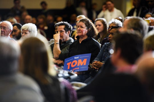 Supporters of democratic presidential hopeful Tom Steyer listen as he campaigns at the West End Community Development Center Monday, Feb. 17, 2020.