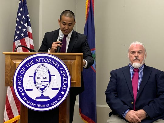 Attorney General Leevin Camacho, left, and chief prosecutor Basil O'Mallan conduct a press briefing Feb. 18 at the ITC Building related to the alleged use of excessive force by a Guam police officer.