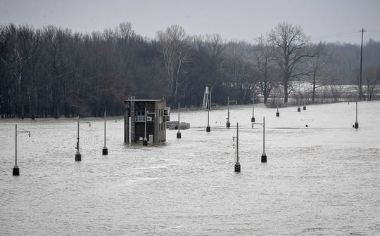 The Spottsville Lock and Dam on the Green River was under water Tuesday. But the floodwaters are expected to begin dropping sharply this week after cresting Tuesday night or early Wednesday.