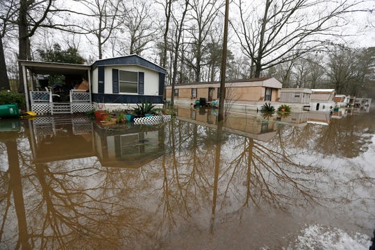 Standing floodwater from the Pearl River surrounds a number of mobile homes in the Harbor Pines community in Ridgeland, Miss., Tuesday, Feb. 18, 2020. While much of the water in the community receded overnight, there are areas that still have high water.