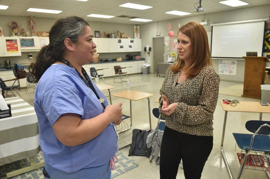 Dr. Felicitas Koller (left) and Brookhaven School District health science instructor Chassity Avants talk during a training session where Koller and and a team of medical students taught high school students how to stop bleeding from a traumatic injury.