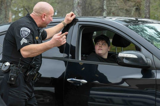 Ridgeland Police officer Kevin Mathis talks to a Harbor Pines neighborhood resident to determine if they can return to their home affected by flood waters Tuesday, Feb. 18, 2020.