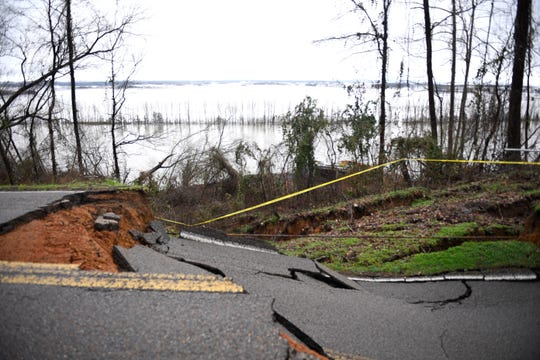 Glendale Road is closed from Chalk Bluff Lane to Small Road due to heavy rain Tuesday, Feb. 18, 2020 in Hardin County, Tenn.