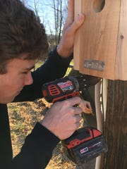 James Walker Whitehead carefully anchors a bluebird box in January 2020.