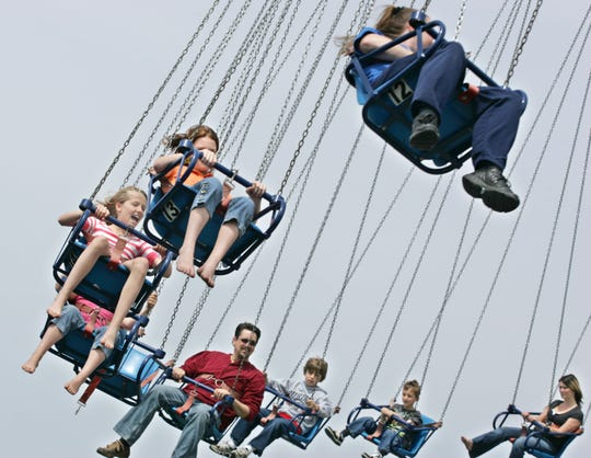 By John Terhune/Journal & Courier--Youngsters laugh and scream while riding the Water Swing during opening weekend Sunday, May 3, 2009, at Indiana Beach in Monticello. The amusement park has dropped the $2.50 general admission fee, relying instead on tickets sold for the rides, water park and midway.