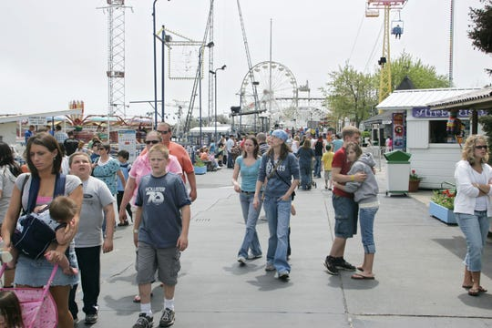 By John Terhune/Journal & Courier--The midway is full during opening weekend Sunday, May 3, 2009, at Indiana Beach in Monticello. The amusement park has dropped the $2.50 general admission fee, relying instead on tickets sold for the rides, water park and midway.