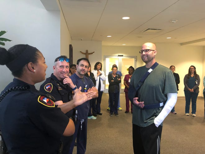 Wade Berzas, right , shares goodbyes with Our Lady of Lourdes team members and first responders before leaving hospital on Feb. 17. Berzas was the lone survivor of a December plane crash in Lafayette that left five others dead.