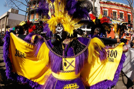 A member of the Zulu parade walks along St. Charles Avenue on Mardi Gras day on Feb. 24, 2009, in New Orleans, Louisiana.