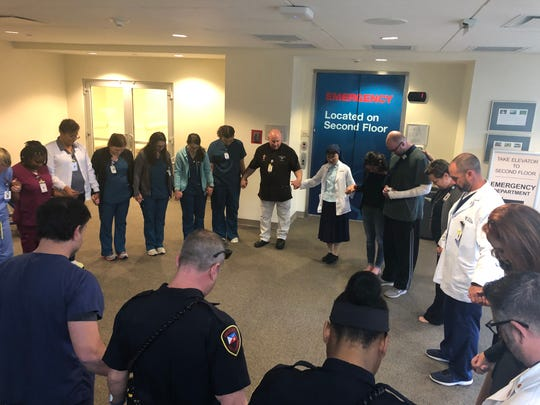 Our Lady of Lourdes Team Members pray over Wade and Mackenzie Berzas before they depart from the hospital on Feb. 17, 2020. Berzas was the lone survivor of a December plane crash in Lafayette that left five others dead.