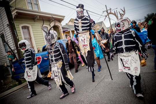 The traditional Skull and Bones Gang wake up residents of the Treme neighborhood of New Orleans on Mardi Gras morning, February 13, 2018.