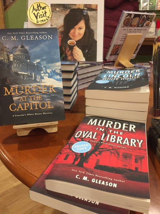Copies of some of Brighton Township author Colleen Gleason's historical murder mysteries are shown on display Tuesday, Feb. 18, 2020, at 2 Dandelions Bookshop in Brighton.