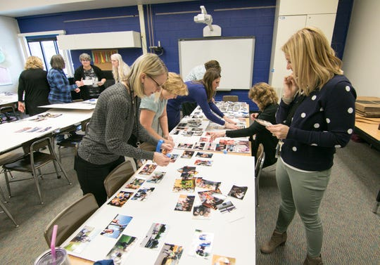 At the near table, from left, kindergarten teacher Jennifer Conway, retired teacher Karen Reed, kindergarten teachers Annie Haaseth and Melissa Decheim were among those gathering at Village Elementary in Hartland Tuesday, Feb. 18, 2020 to assemble memory boards for the funeral service of former district employee Bill Cain.