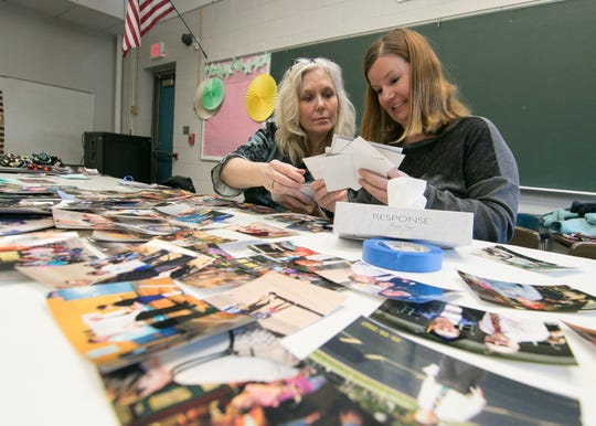 Village Elementary School art teacher Kirsten Eichhorn, left, and fellow teacher Erin Peifer, who was hired by Bill Cain around 2006, were among the school district faculty that gathered at Village Elementary School on Tuesday, Feb. 18, 2020 to assemble memory boards for the funeral service of former district employee Bill Cain, who passed away Feb. 7.