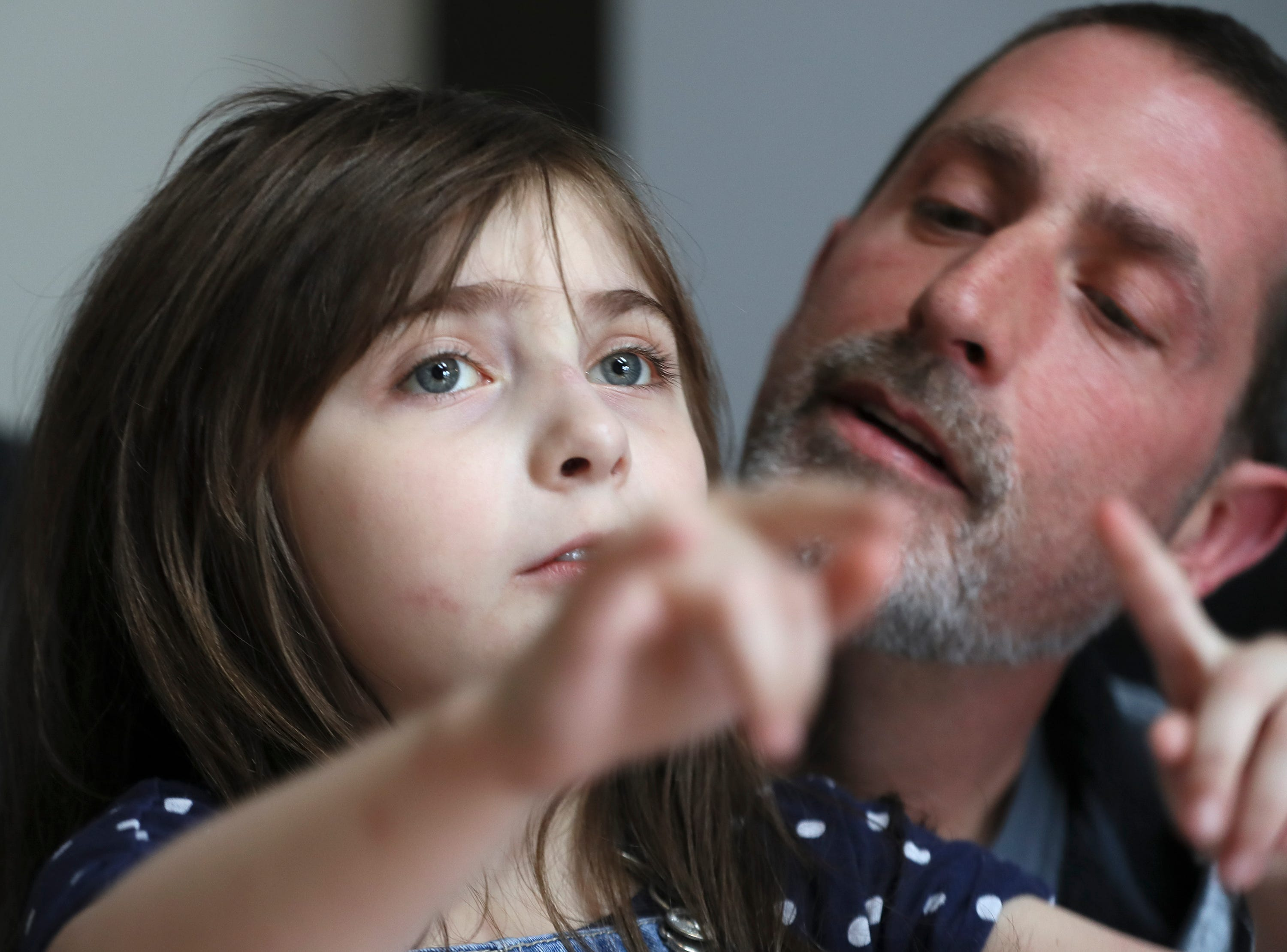Brian Carroll works on communication with his daughter, Pepper, 7, who has autism and is nonverbal on Feb. 9, 2020.