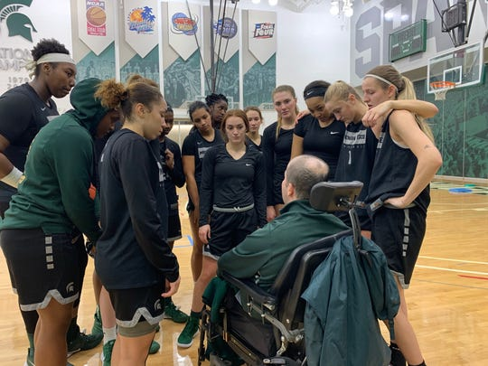 Mo Gerhardt, center, talks to the MSU women's basketball team following a practice in early January.  Gerhardt, the color analyst for MSU women's basketball radio broadcasts, has been away from the team this season while dealing with health issues.
