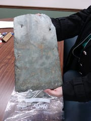 Dayspring, Richland County's assisted living facility, is in need of a roof replacement. Michelle Swank, Dayspring director, holds a piece of the 95-year-old slate that currently covers the historic building.
