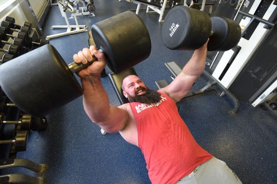 Matt Trammel works with dumbbells at the Mansfield Area Y.
