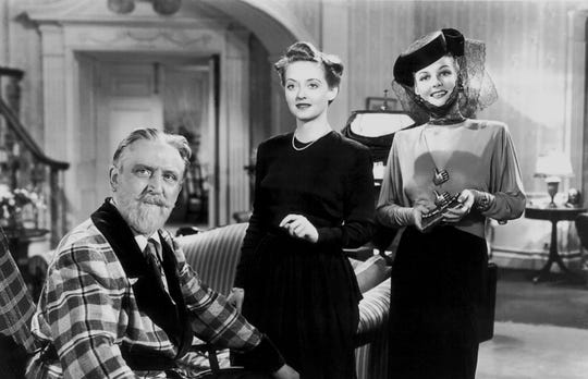 Monty Woolley, Bette Davis and Ann Sheridan in 'The Man who Came to Dinner,' in 1942.