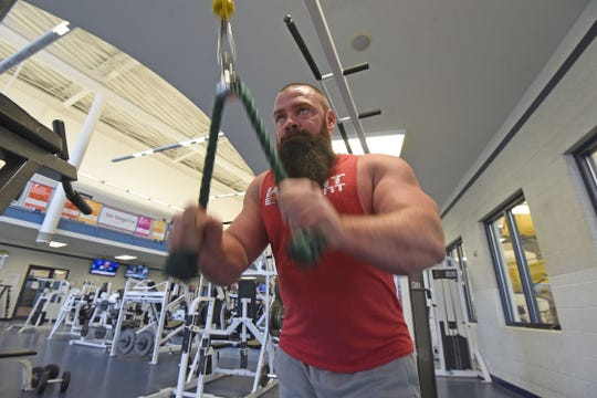 Powerlifting pastor Matt Trammel works his triceps during a workout at the Mansfield Area Y.