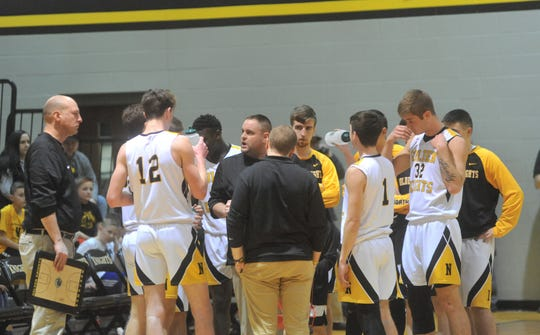 Zach Ruth talks to his Northmor basketball team during a timeout in a game this past season against Colonel Crawford.