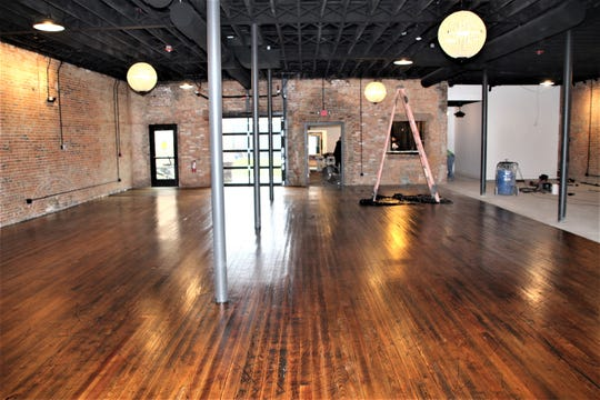 The finishing touches are being applied to the ballroom of The Brickyard on Main, 135 S. Main St. in downtown Marion. Workers finished applying a polyurethane coating to the hardwood floor on Monday evening. Also visible is the signature exposed brick, much of which dates back to the 1800s, and the exposed wooden beams in the ceiling.