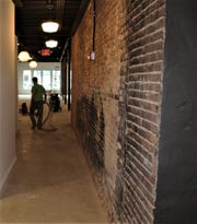 The Brickyard on Main's hallway that leads from the ballroom to the bridal lounge and groom's dressing room features the signature exposed brick.
