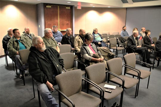 "Members of Ohio Stands United Marion County listen as group member and leader Dennis Tubbs addresses the Marion County Board of Commissioners on Tuesday morning. The group has submitted a resolution to the commissioners asking them to declare Marion County a ""Constitutional 2nd Amendment County."""
